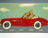 A dog in his racing goggles takes the car out for a spin.  It's a lovely day for a drive on a handmade ceramic tile
