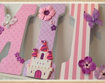 Princess Nursery. Butterfly Nursery Letters. Wall Letters. Wood Letters. Name letters. Tiddliwinks. Stripes. Purple. Pink. Tiara. Flowers.