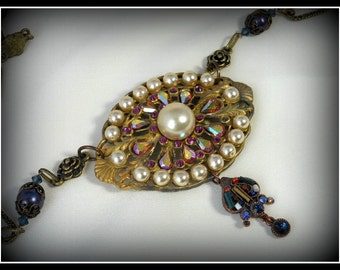 Repurposed necklace with tibetan chain, pearls, swarofski rhinestones and dangling earring.
