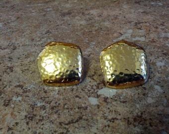 Lovely Evoke signed pierced earrings in gold tone metal