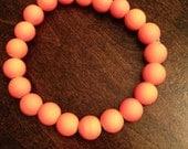 Neon orange beaded bracelet