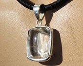 Positively Negative Quartz  Set in Hand  Crafted Sterling Silver Pendant