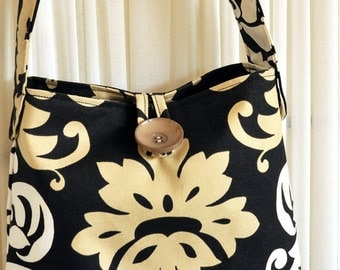 Black, white and cream handbag