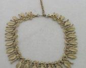 Vintage gold toned leaf Lisner choker necklace designer signed