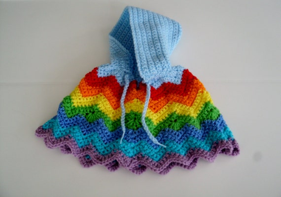 Poncho is worked in a ripple crochet pattern  :: nelrepotly cf