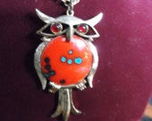 Owl Necklace Vintage 1970 s gold tone  with red eyes and red stone.epsteam