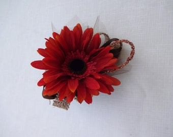 Corsage in rust gerber daisy trimmed in burlap