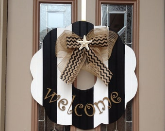 Black and white beadboard striped wooden wreath with burlap bow with starfish