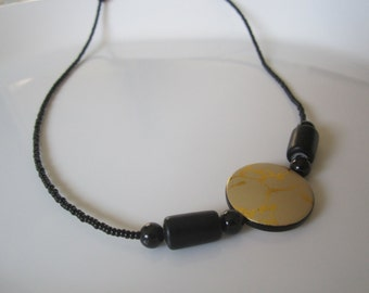 SALE **Crackle yellow/gold round lentil with black seed beads