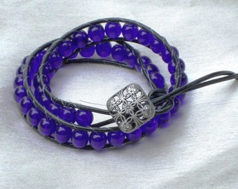 Leather wrap bracelet - cobalt blue glass beads with metal button on black leather
