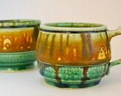 Handmade mug, green, ochre yellow, chattering detail, fake ash