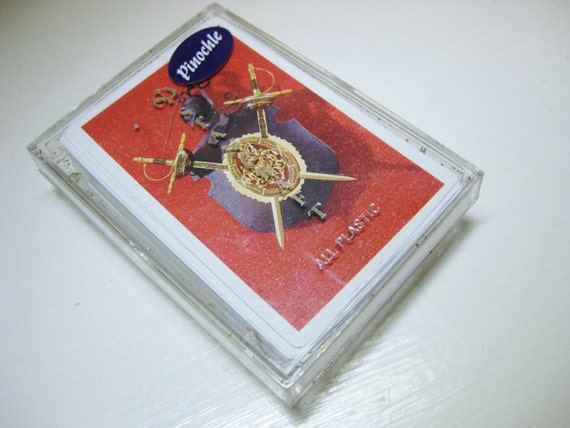 Card deck. Stancraft Playing Cards. All-plastic Pinochle deck with coat-of-arms art. Vintage. Heraldry. Glitter case.