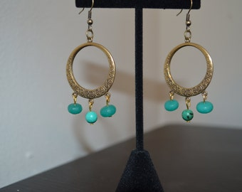 Antique gold hoop earrings with green colored beads