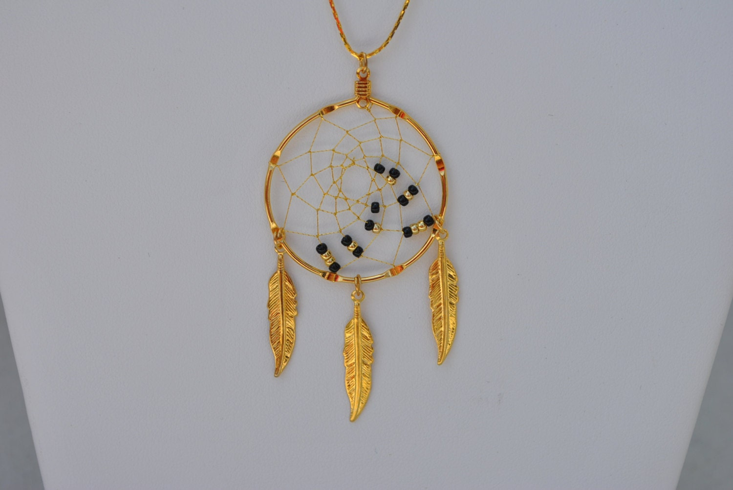 Handmade gold dreamcatcher necklace with black and gold beads for Dreamcatcher beads meaning