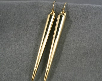 Long gold plated cone shaped earrings