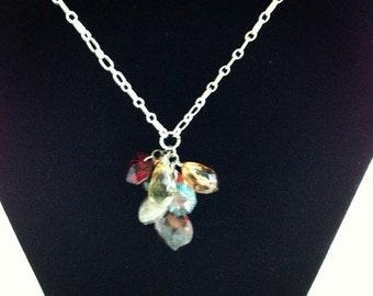 Multi colored bead dangles on a silver chain