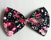 Cute large lolita bow with hearts, strawberries and bows.