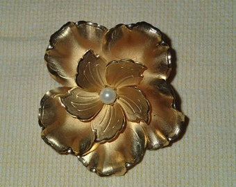 Vintage 1950s Gold colored aluminum Brooch with adorned Faux Pearl center
