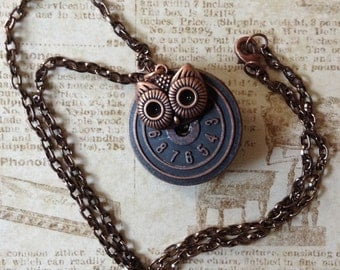 Steampunk inspired owl on a clock