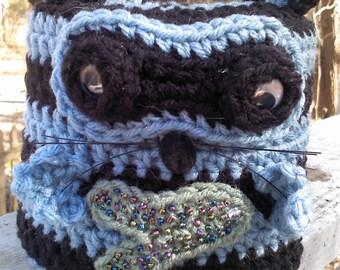 crochet,toilet paper cover,bathroom,raccoon,wildlife,animal,whimsical.