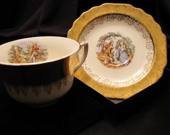 22 Karat Gold Warranted Cup and Saucer Set