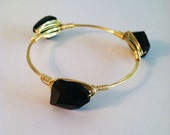 The Auburn - gold wire wrapped bracelet bangle with faceted black bead