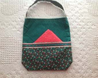 Christmas fabric gift bag made from vintage fabric.
