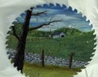 "12"" Oil Painted Circular Saw Blade.  Scene is Rural with a Rock Wall, Tree, and a Shed in the background"