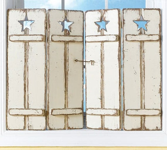 Distressed Wooden Shutters With Traditional Star Cutout In