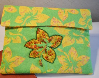 Tablet sleeve universal size made of 100 percent cotton tropical fabric,  lined and padded.  one of a kind handmade