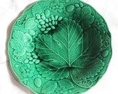 Majolica green plate with vine leaf and strawberry design. George Jones stamp