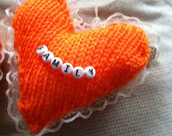small personalised knitted hearts, with ribbon. decorated with beads or lace