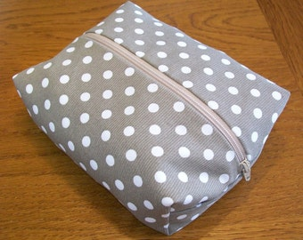 Polka dot zip clutch