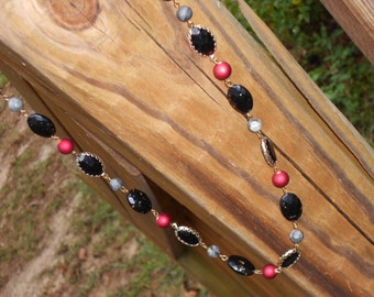 Red and Black long necklace with Gold accents On Sale