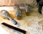 RESERVED for Raindancer.   Sterling silver vanity set. Heavily repoussed brush, comb, clothes brush, and hat brush.