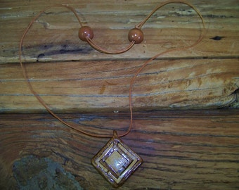 Wooden necklace piece