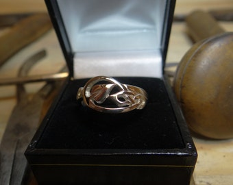 Sterling silver ring, heart shaped leaf and celtic knot motif