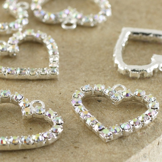 12 Diamante heart charms. Silver AB 17 x 19mm. JR07068 BULK