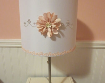Girly Glam Lamp w/white lamp shade, soft peachy-pink floral embellishment, crystal-like embellishments,  border w/slight sparkle.  Princess!