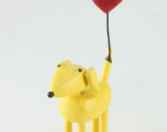 Yellow dog with heart balloon
