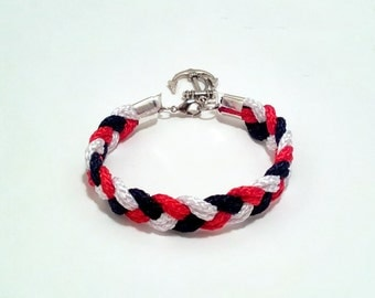 Navy blue, white and red braided nautical rope bracelet with silver anchor charm