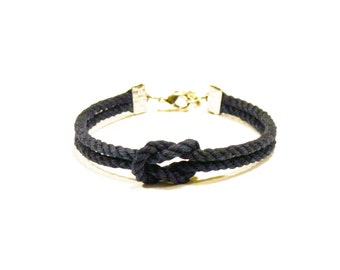 Matte navy blue forever knot nautical rope bracelet with silver anchor charm