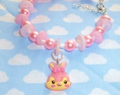 Pretty pink bead and button bracelet with bunny charm On Sale