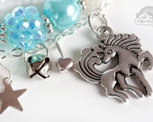 Unicorn mint and silver bracelets with small metallic charms