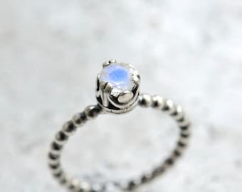 Rainbow moonstone ring. Sterling silver ring with faceted blue flash moonstone. Made to order