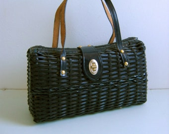 Original Vintage 1950 1960 Plastic coated straw Purse. Made in Hong Kong.  Leather handle and trim.  Dark Navy Blue.