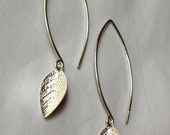 tiny silver leaves dangling from long silver ear hooks