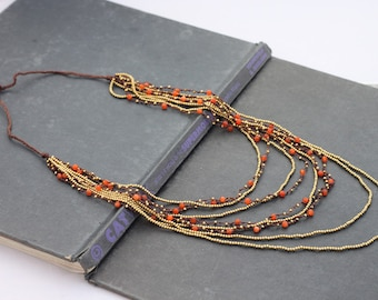 Layered Nine Strand Red Aventurine Woven Necklace
