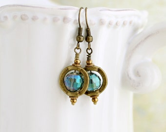 Mermaid drop earring in brass bead frames - blue green faceted crystals reflect the sparkly of the watery deep.