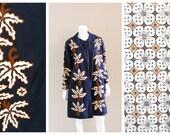 Vintage Batik print reversible coat. Handmade and handprinted cotton navy blue and tan tropical flower design. 1950s.